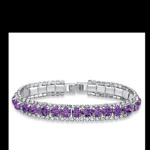 Amethyst and silver tone tennis bracelet